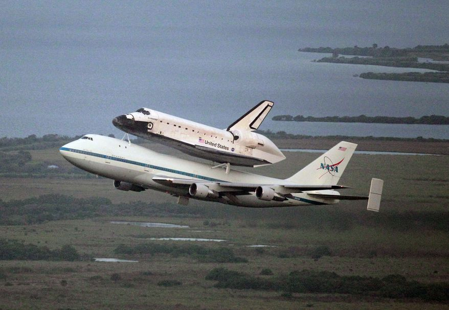 Space shuttle Endeavour, bolted atop a modified jumbo jet, makes its departure on Sept. 19, 2012, from the Kennedy Space Center in Cape Canaveral, Fla. Endeavour will make a stop in Houston before heading to the California Science Center in Los Angeles. (Associated Press)