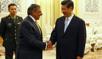 Defense Secretary Leon E. Panetta (center) shakes hands with Chinese Vice President Xi Jinping at the Great Hall of the People in Beijing on Wednesday, Sept. 19, 2012. (AP Photo/Larry Downing, Pool)