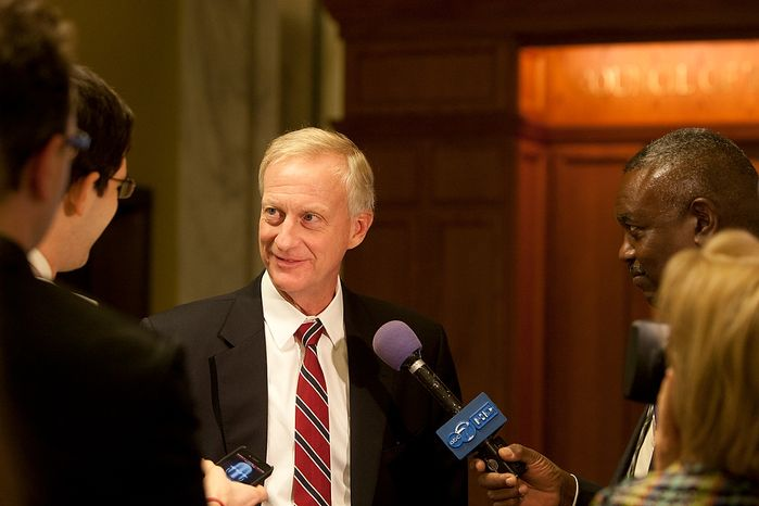 D.C. City Council member, Jack Evans, answers question before attending the first meeting after summer recess, Wednesday, Sept. 19, 2012, in Washington, DC. Chairman, Phil Mendelson, called for the 42nd legislative meeting of council period 19 after summer recess. (Craig Bisacre/The Washington Times)
