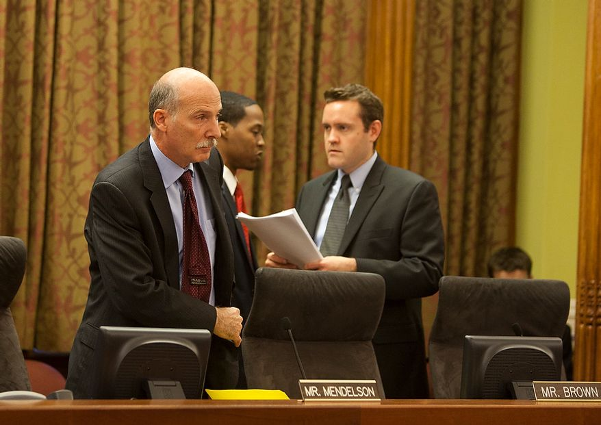 D.C. City Council Chairman, Phil Mendelson, takes his seat before the 42nd legislative meeting of City Council period 19 after summer recess. Wednesday, Sept. 19, 2012, in Washington, DC. (Craig Bisacre/The Washington Times)