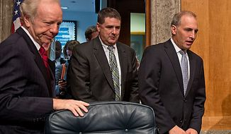 Sen. Joseph I. Lieberman (left), Connecticut independent, takes his seat as FBI Associate Deputy Director Kevin Perkins (center) and National Counterterrorism Center Director Matthew G. Olsen arrive to testify on homeland threats and agency responses in front of the Homeland Security and Governmental Affairs Committee on Capitol Hill in Washington on Wednesday, Sept. 19, 2012. (Andrew Harnik/The Washington Times)