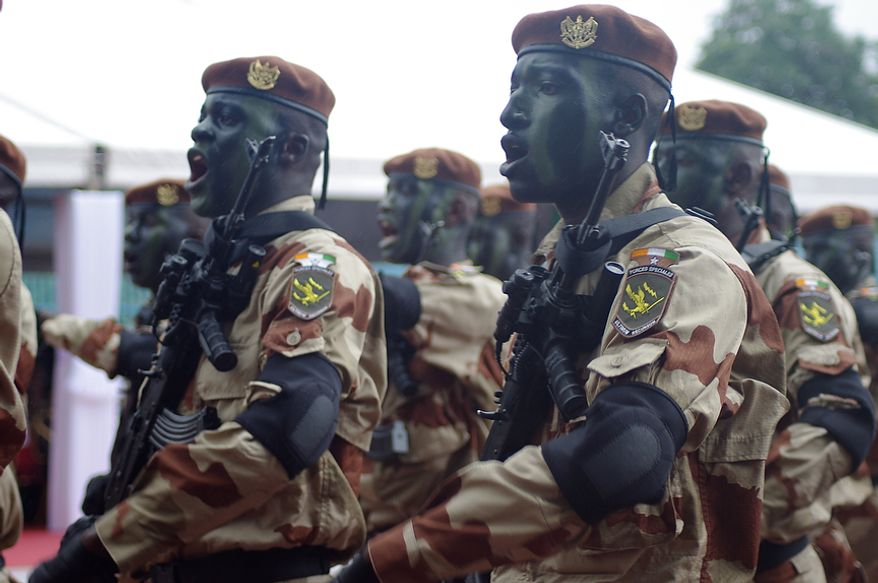 Members of Ivory Coast's armed forces march during the country's Independence Day celebrations on Tuesday, Aug. 7, 2012. (Robbie Corey-Boulet/Special to The Washington Times)