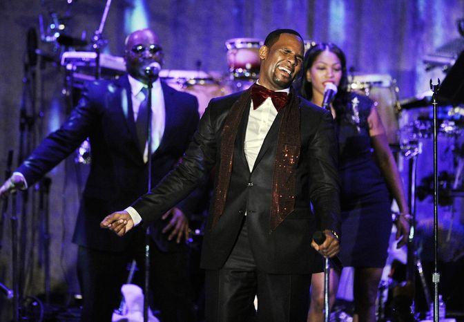 **FILE** R. Kelly performs Feb. 12, 2011, at the pre-Grammy gala and salute to industry icons in Beverly Hills, Calif. (Associated Press)