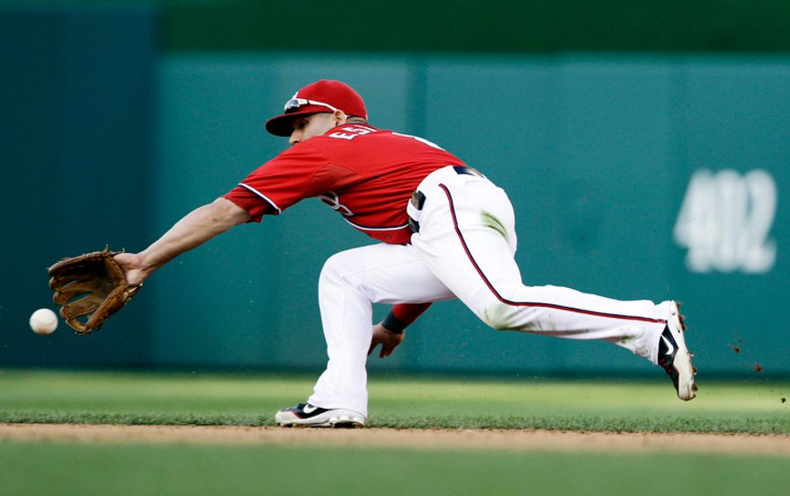 Washington Nationals second baseman Danny Espinosa fields a ball hit by Los Angeles Dodgers' Shane Victorino, who was out when Espinosa made the throw to first, during the sixth inning of the first baseball game of a doubleheader at Nationals Park, Wednesday, Sept. 19, 2012, in Washington. The Nationals won the first game 3-1. (AP Photo/Alex Brandon)