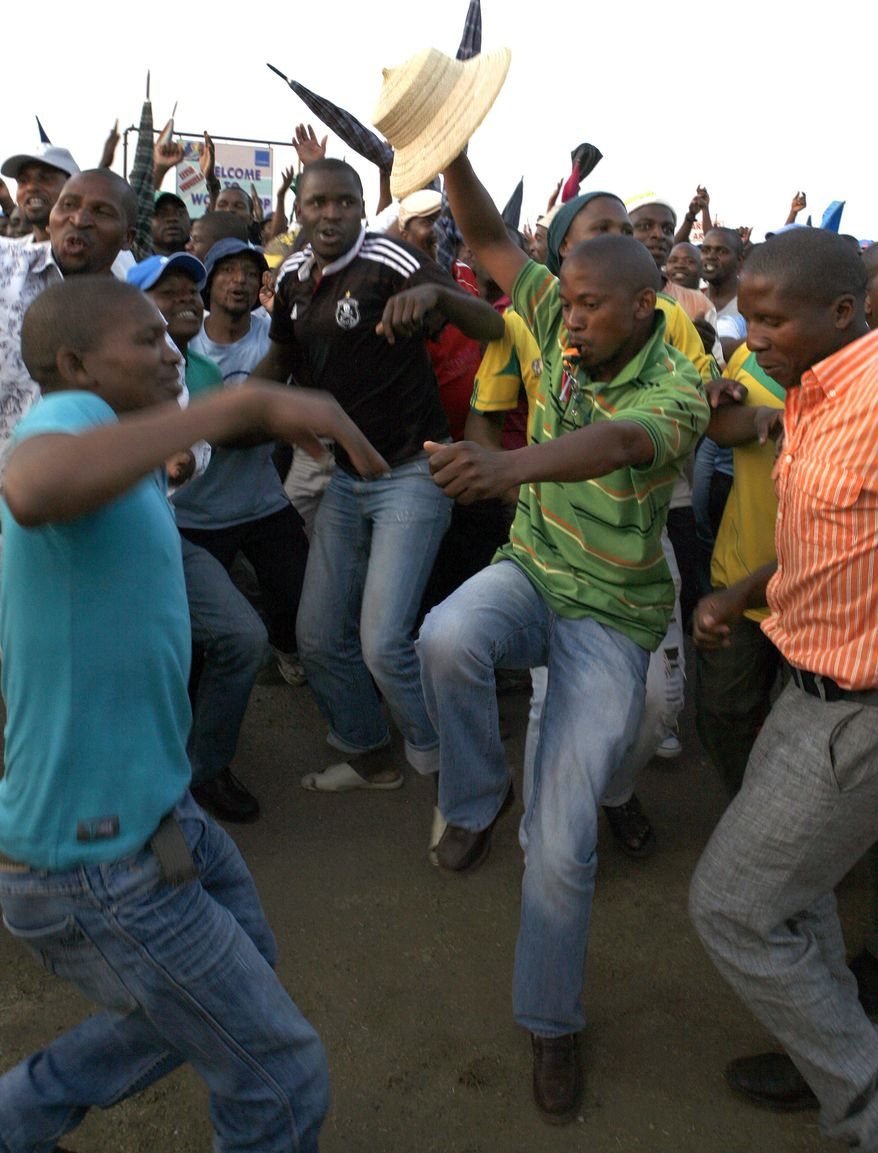 Miners sing and dance Sept. 18, 2012, after accepting a pay raise in Lonmin Platinum Mine near Rustenburg, South Africa, ending a strike and more than five weeks of crippling and bloody industrial action. (Associated Press)
