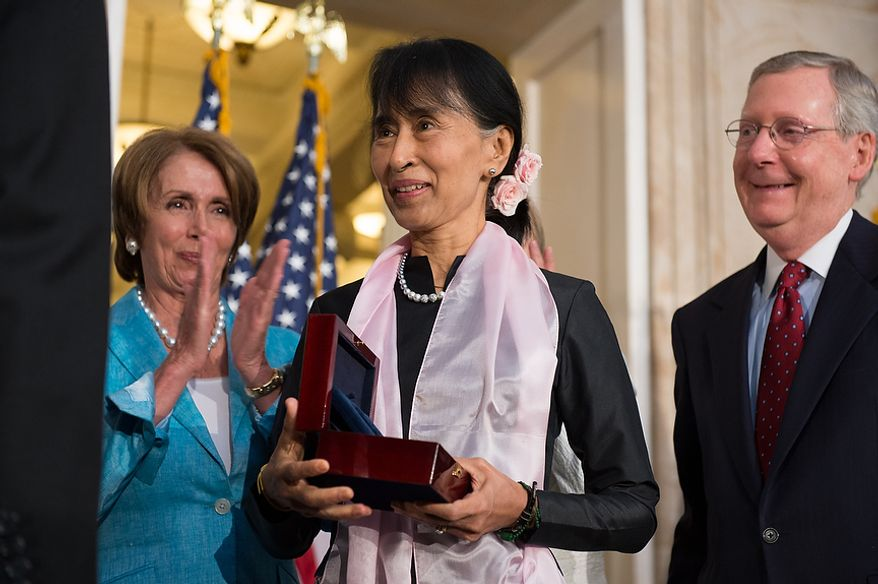 House Democratic Leader Nancy Pelosi (D-Calif.), left, and Senate Republican Leader Mitch McConnell (R-Ky.), right, look on as Chairperson and General Secretary of the National League for Democracy Aung San Suu Kyi of Myanmar, also known as Burma, is awarded the Congressional Gold Medal in the Capitol rotunda, Washington, D.C., Wednesday, September 19, 2012. (Andrew Harnik/The Washington Times)