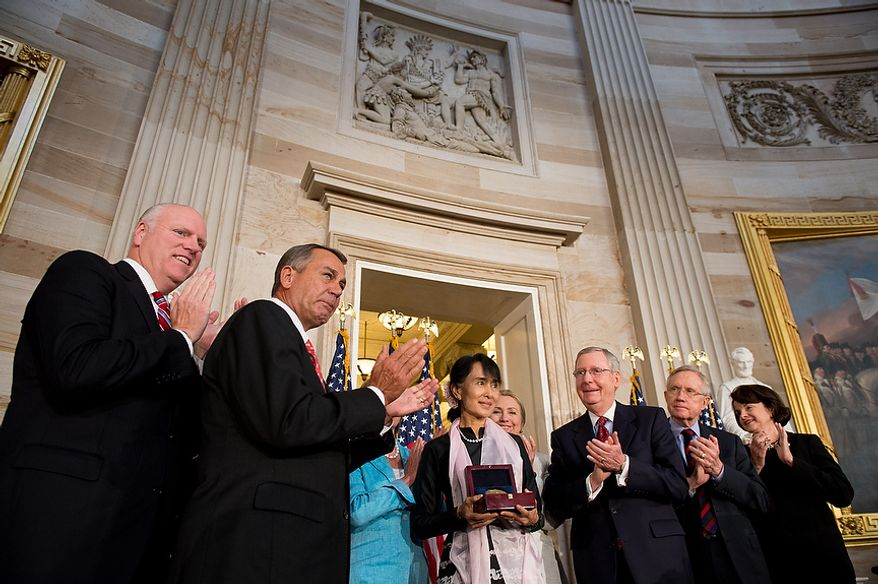 Rep. Joseph Crowley (D-N.Y.), left, Speaker of the House John Boehner (R-Ohio), second from left, Secretary of State Hillary Rodham Clinton, fourth from right, Senate Republican Leader Mitch McConnell (R-Ky.), third from right, Senate Majority Leader Harry Reid (D-Nev.), second from right, and Sen. Dianne Feinstein (D-Calif), right, applaud as Chairperson and General Secretary of the National League for Democracy Aung San Suu Kyi of Myanmar, also known as Burma, is awarded the Congressional Gold Medal in the Capitol rotunda, Washington, D.C., Wednesday, September 19, 2012. (Andrew Harnik/The Washington Times)