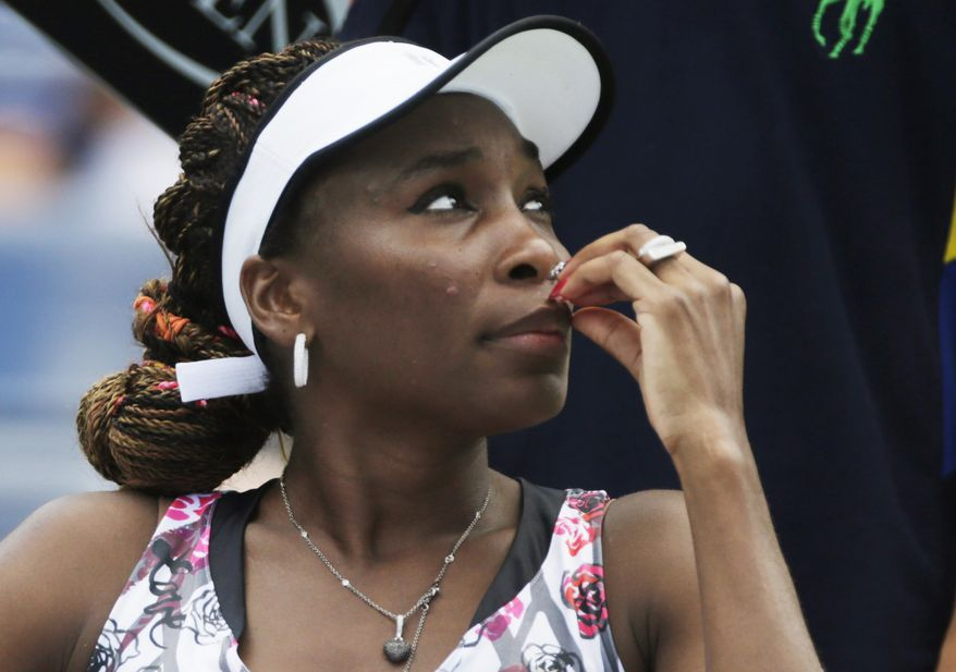 Venus Williams waits to resume play during her match against Bethanie Mattek-Sands during the first round of play at the 2012 US Open tennis tournament, Tuesday, Aug. 28, 2012, in New York. (AP Photo/Charles Krupa)