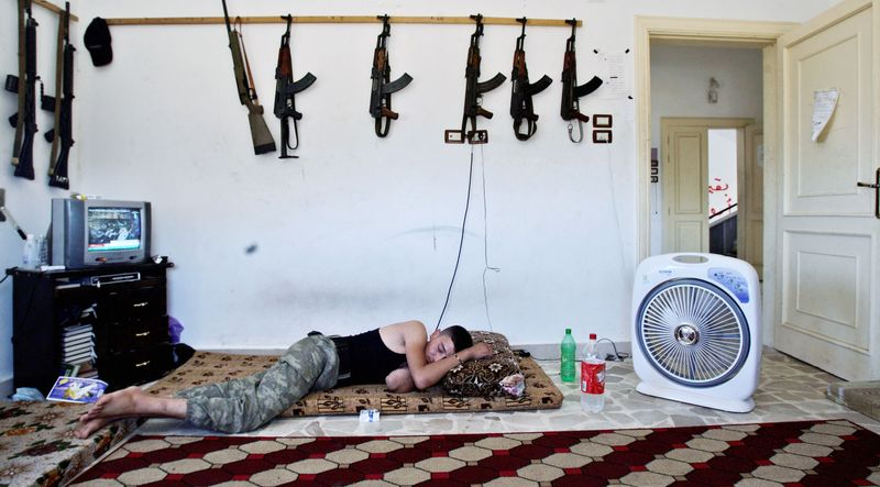 A Syrian rebel sleeps last month after fighting government forces in Aleppo. A 60-member coalition called Friends of the Syrian People, recognizing tha