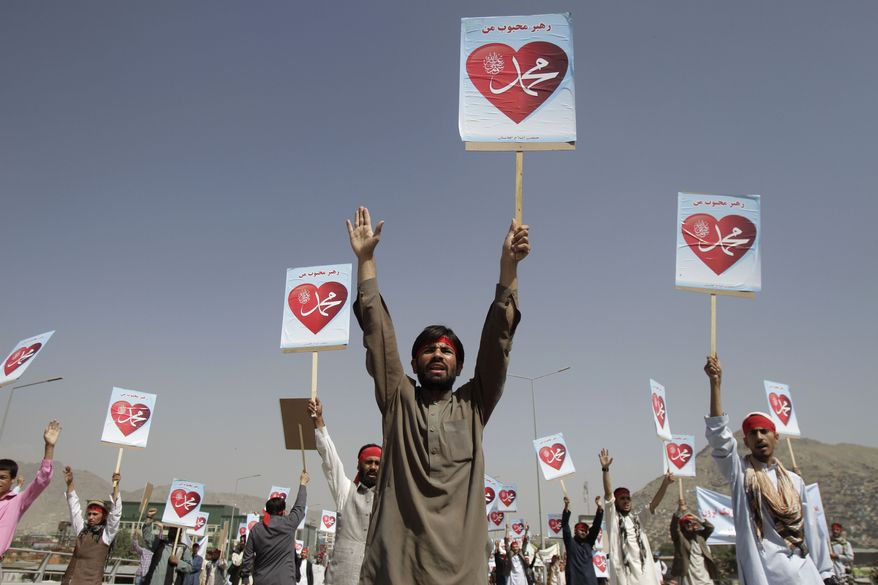 "Afghan protesters hold placards with the slogan ""Our leader Mohammed"" during a demonstration against an anti-Islam film in Kabul, Afghanistan, on Thursday, Sept. 20, 2012. (AP Photo/Ahmad Jamshid)"