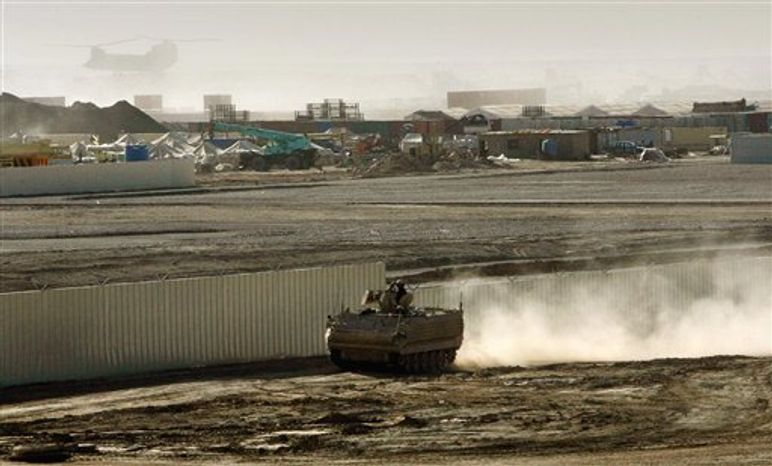 ** FILE ** A British armored vehicle patrols on the periphery of the camp Bastion in southern Afghanistan, in this Wednesday, Jan. 10, 2007, file photo. (AP Photo/Manish Swarup, File)
