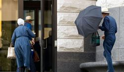 Amish enter the federal courthouse in Cleveland on Thursday, Sept. 20, 2012, as a jury began the fifth day of deliberations in the trial of 16 Amish accused of hate crimes in hair- and beard-cutting attacks against fellow Amish in Ohio. (AP Photo/Scott R. Galvin)