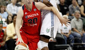 Washington Mystics guard Natalie Novosel (20) drives past Minnesota Lynx forward Taj McWilliams-Franklin (8) in the first half of a WNBA basketball game, Friday, Aug. 17, 2012, in Minneapolis. (AP Photo/Stacy Bengs)