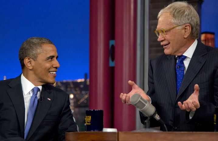 "President Obama talks with host David Letterman on the set of ""Late Show With David Letterman"" at the Ed Sullivan Theater in New York on Tuesday, Sept. 18, 2012."