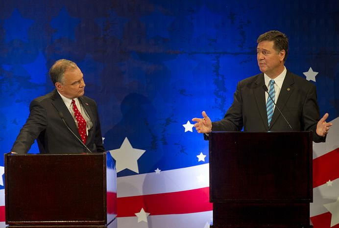 Former Virginia Gov. Tim Kaine, left, listens as rival candidate for U.S. Senate former Gov. George Allen talks during their first debate at the Capital One Conference Center in Tysons Corner, Va., on Thursday, Sept. 20, 2012. Thi