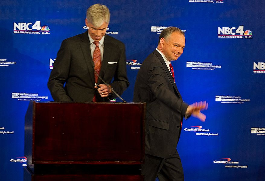 Former Virginia Gov. Tim Kaine, right, waves to the audience after shaking hands with moderator David Gregory at the beginning of the 2012 U.S. Senate Debate on Thursday, Sept. 20, 2012 at the Capital One Conference Center in McLean, Va. (Barbara L. Salisbury/The Washington Times)
