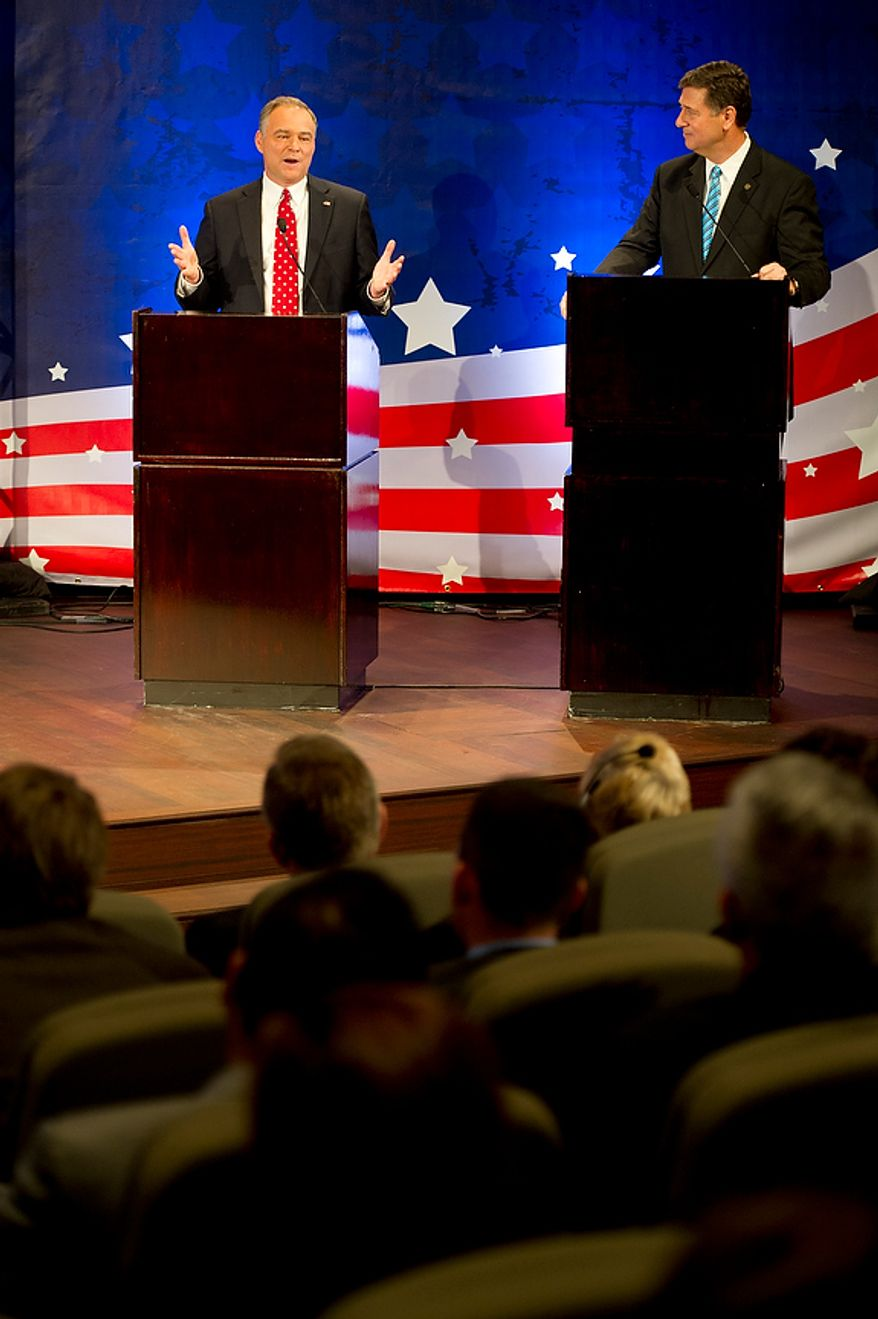 George Allen, right, looks on while opponent Tim Kaine talks during the 2012 U.S. Senate Debate, their first of three debates, held Thursday, Sept. 20, 2012 at the Capital One Conference Center in McLean, Va. The two men, who are both former governors of Virginia, are locked in what has been called the most competitive race in the nation. (Barbara L. Salisbury/The Washington Times)