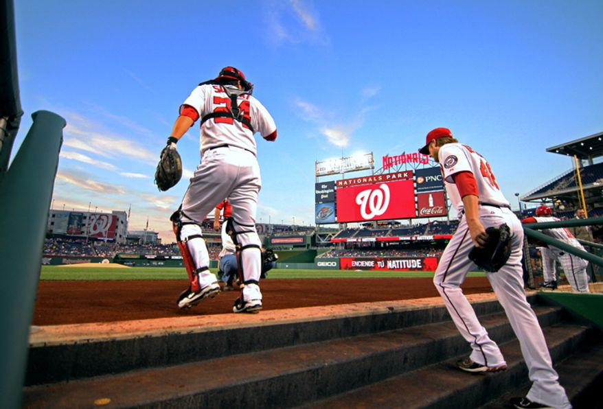 Washington Nationals starting pitcher Ross Detwiler (48) and Washington Nationals catcher Kurt Suzuki (24) take the field to start the game against Los Angeles Dodgers at Nationals Park. (Craig Bisacre/The Washington Times)