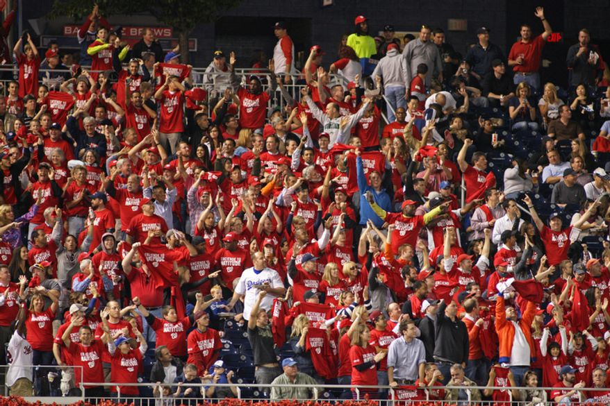 Washington Nationals fans show their spirit in left field against Los Angeles Dodgers at Nationals Park. (Craig Bisacre/The Washington Times)