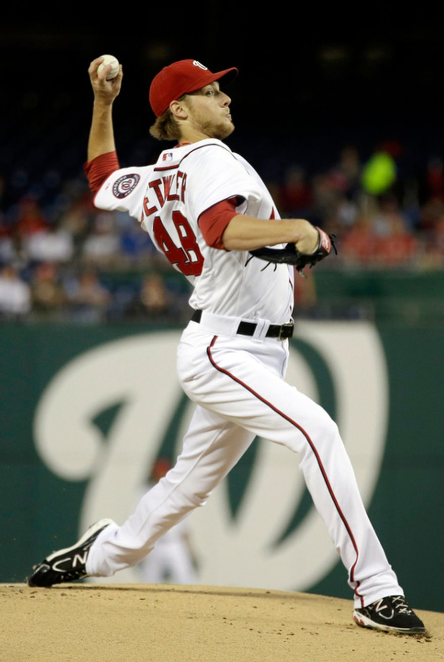 Washington Nationals starting pitcher Ross Detwiler (48) throws a pitch against the Los Angeles Dodgers during the first  inning of a baseball game at Nationals Park, in Washington. (AP Photo/Jacquelyn Martin)