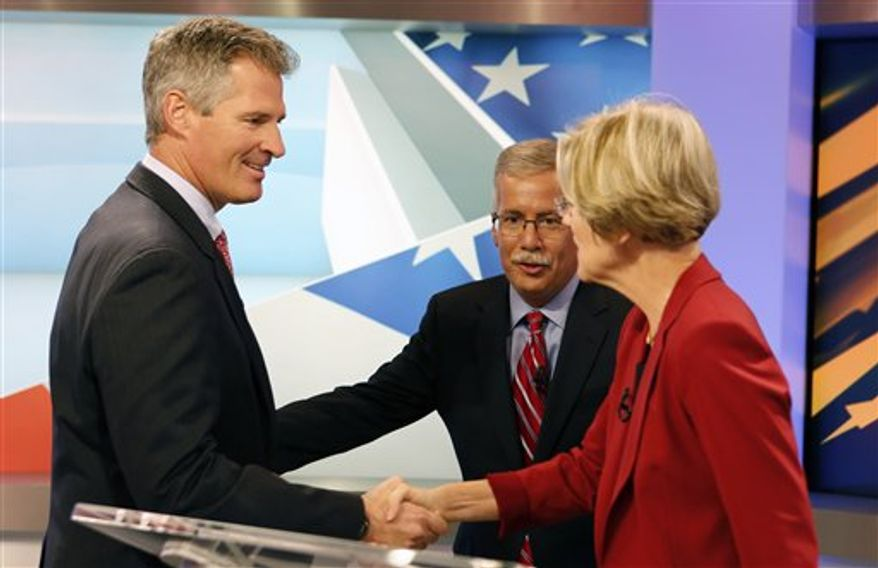 ** FILE ** Sen. Scott Brown, Massachusetts Republican, left, shakes hands with his Democratic challenger Elizabeth Warren, right, on the set before their first debate as moderator Jon Keller, center, looks on, Thursday, Sept. 20, 2012, in Boston. (AP Photo/Michael Dwyer)