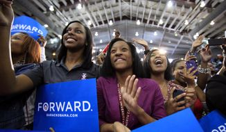 North Carolina Central University student Aaliyah McMillan (center) cheers for first lady Michelle Obama as she speaks at the Durham, N.C., school on Sept. 19, 2012. (Associated Press/The News & Observer, Takaaki Iwabu)