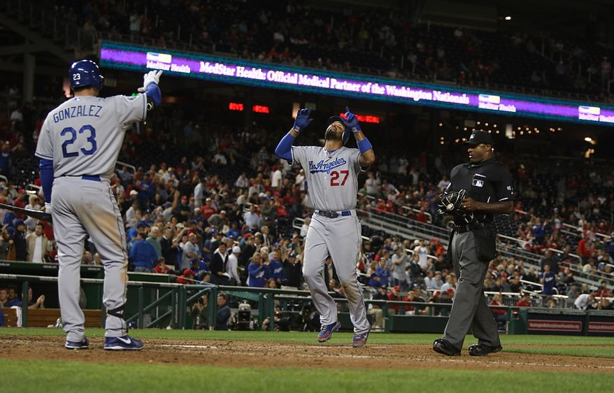 Los Angeles Dodgers center fielder Matt Kemp (27) celebrates as he crosses home plate after hitting a solo game winning go ahead run in the ninth inning, Wednesday, Sept. 19, 2012, in Washington, DC. Washington Nationals lose to the Los Angeles Dodgers 6 to 7 in the second game of the doubleheader at National Park (Craig Bisacre/The Washington Times)