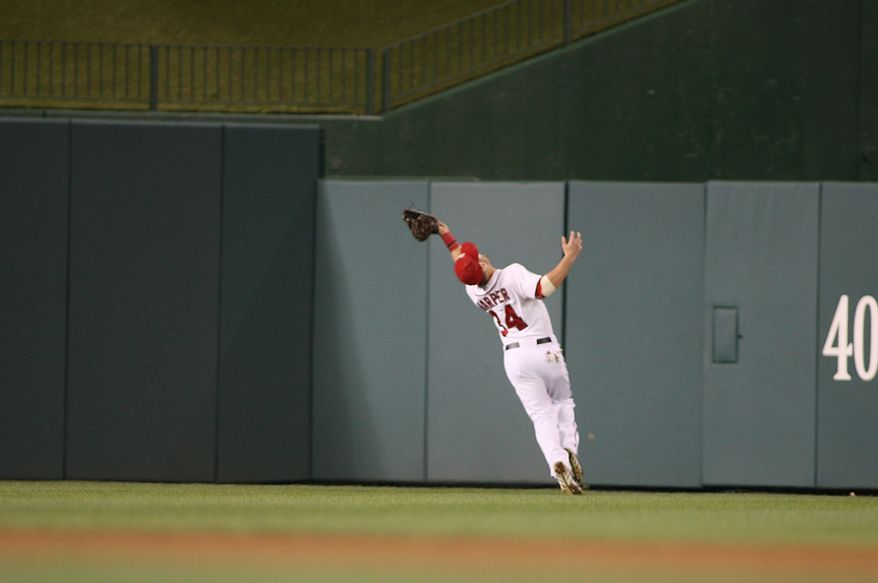 Washington Nationals center fielder Bryce Harper (34) makes a catch in center field during the firth inning, Wednesday, Sept. 19, 2012, in Washington, DC. Washington Nationals lose to the Los Angeles Dodgers 6 to 7 in the second game of the doubleheader at National Park (Craig Bisacre/The Washington Times)