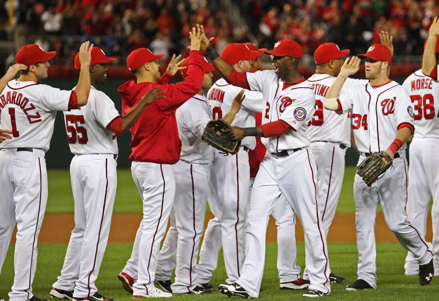 Washington Nationals celebrate after beating the Los Angeles Dodgers 4-1at Nationals Park, Thursday, Sept. 20, 2012, in Washington, DC. The Washington Nationals clinched a spot in the playoff for the first time in team history. (Craig Bisacre/The Washington Times)