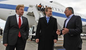 U.S. Secretary of Defense Leon Panetta (right) is welcomed to Auckland, New Zealand, by New Zealand's Minister of Defense Jonathan Coleman (center) and U.S. Ambassador to New Zealand David Huebner on Sept. 21, 2012. (Associated Press)