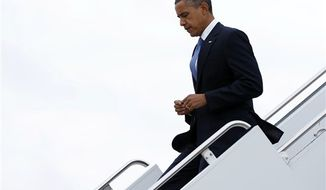 ** FILE ** President Barack Obama arrives on Air Force One at John F. Kennedy International Airport, Tuesday, Sept. 18, 2012, in New York. (AP Photo/Carolyn Kaster)
