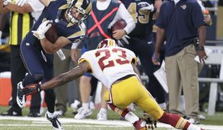 St. Louis Rams wide receiver Danny Amendola (16) eludes the grasp of Washington Redskins cornerback DeAngelo Hall (23) during the second quarter of an NFL football game Sunday, Sept. 16, 2012, in St. Louis. (AP Photo/Tom Gannam)