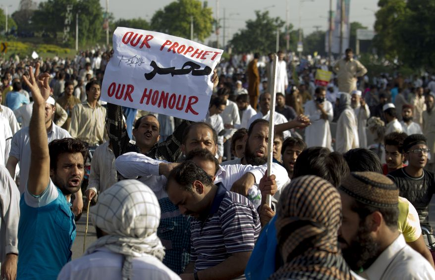 Hundreds of Pakistanis angry over an anti-Islam film that denigrates the religion's prophet protest in Islamabad on Thursday, Sept. 20, 2012. (AP Photo/B.K. Bangash)