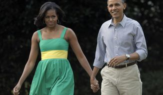 **FILE** President Obama and his wife, Michelle, arrive June 27, 2012, at the Congressional picnic on the South Lawn of the White House in Washington. (Associated Press)