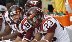 Virginia Tech safety Boye Aromire (23) sits on the bench with teammates as they are losing to Pittsburgh in the NCAA football game, Saturday, Sept. 15, 2012 in Pittsburgh. Pittsburgh upset Virginia Tech 35-17. (AP Photo/Keith Srakocic)