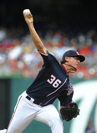** FILE ** Washington Nationals' relief pitcher Tyler Clippard records his 30th save of the season against the Chicago Cubs during their baseball game at Nationals Park, Monday, Sept. 3, 2012, in Washington. (AP Photo/Richard Lipski)