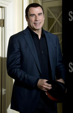 John Travolta  arrives Sept. 19, 2012, at the photo call for Oliver Stone's drug-war film 'Savages' at a central London hotel. (Associated Press)