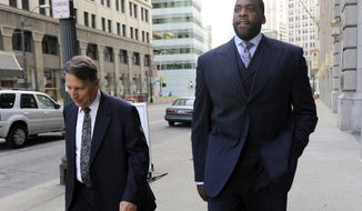 **FILE** Former Detroit Mayor Kwame Kilpatrick walks to federal court on Sept. 6, 2012 in Detroit with attorney Jim Thomas. Kilpatrick, his father Bernard, former city water boss Victor Mercado and Kilpatrick associate Bobby Ferguson are accused of a sweeping corruption scheme. (Associated Press/Detroit News)
