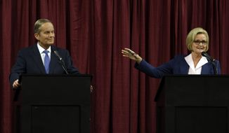 Democratic Sen. Claire McCaskill (right) speaks Sept. 21, 2012, as she looks toward Republican challenger Rep. Todd Akin during the first debate in the Missouri Senate race in Columbia, Mo. (Associated Press)