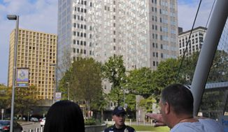 Police block off the area around Three Gateway Center office building in downtown Pittsburgh, where they are negotiating with a man who claims to have a bomb, on Sept. 21, 2012. A call about an armed man inside the building prompted an evacuation amid reports of a hostage situation. (Associated Press)
