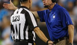 **FILE** New York Giants head coach Tom Coughlin talks Sept. 20, 2012, with official John Vachon during the fourth quarter the Giants' 36-7 win against the Carolina Panthers in Charlotte, N.C. (Associated Press)
