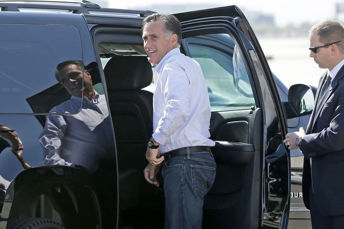 Republican presidential candidate Mitt Romney gets in his vehicle as he arrives in Las Vegas on Sept. 21, 2012. (Associated Press)