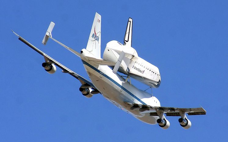 The retired shuttle Endeavour piggybacks a modified Boeing 747 Shuttle Aircraft Carrier during its final flight on Sept. 20, 2012, as the pair soars over White Sands Missile Range east of Las Cruces, N.M., before reaching the landing destination in California. (Associated Press/Las Cruces Sun-News)