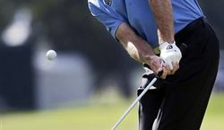 Jim Furyk chips to the green on the 13th hole during the second round of the Tour Championship golf tournament in Atlanta on Friday, Sept. 21, 2012. (AP Photo/John Bazemore)