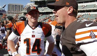 ** FILE ** Cincinnati Bengals quarterback Andy Dalton (14) meets with quarterback Brandon Weeden (3) after an NFL football game, Sunday, Sept. 16, 2012, in Cincinnati. (AP Photo/Tom Uhlman)