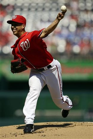 Washington Nationals starting pitcher Gio Gonzalez throws during the first inning of a baseball game against the Milwaukee Brewers at Nationals Park Saturday, Sept. 22, 2012, in Washington. (AP Photo/Alex Brandon)