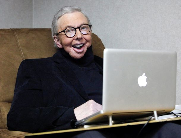 Pulitzer Prize-winning movie critic Roger Ebert works in his office at the WTTW-TV studios in Chicago in Jan