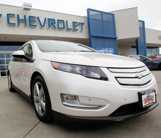A 2012 Chevrolet Volt is featured at a dealership in the south Denver suburb of Englewood, Colo. Sales of the Volt set a monthly record of 2,800 in August, mostly due to steep discounts. (Associated Press)