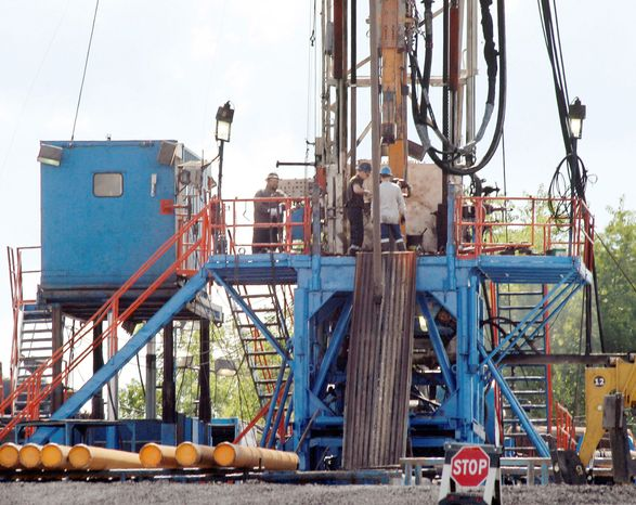 A crew works on a drilling rig at a well site for shale-based natural gas in Zelienople, Pa. Though hydraulic fracturing is thought of as a relatively new technique, the federal government began funding research into it and horizontal drilling in the 1970s. (Associated Press)