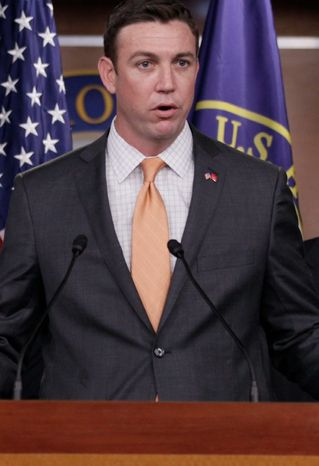 ** FILE ** Rep. Duncan Hunter, California Republican, speaks during a news conference on Capitol Hill on April 7, 2011, in Washin